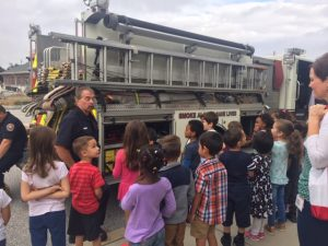 Students learning about a firetruck.