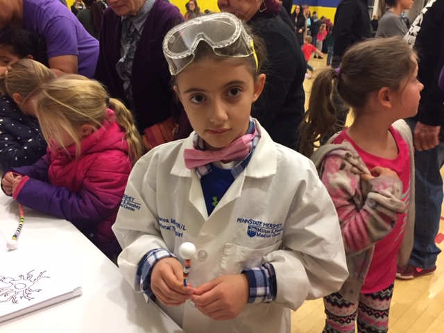 Girl in goggles, bow tie and lab coat