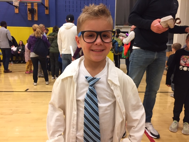 Boy in lab coat and glasses
